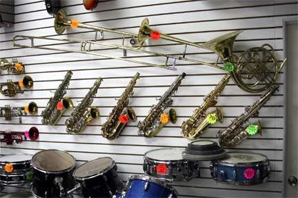 We sell new and used school band musical instruments